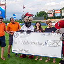 QNB Bank presenting the big Batting for Books check to Allentown Public Library at Coca-Cola Park