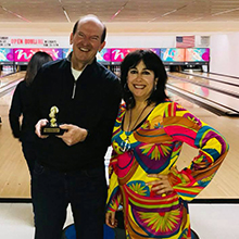 Dave Freeman of QNB Bank holding his turkey trophy at BBBS's Bowl for Kids' Sake event.