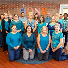 QNB Bank employees wearing teal to support the National Ovarian Cancer Coalition.