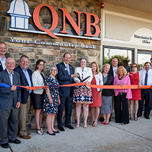 QNB Bank family and friends cutting the ribbon at QNB's Warminster Office grand opening.